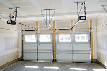 Garage doors repair service on double doors